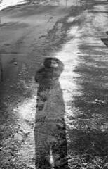 Winter Thaw (savulous) Tags: blackandwhite bw bnw street shootfilm filmphotography film ilford canonet canon giii ql17 selfie selfportrait shadow