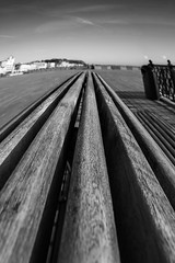 Hastings bench (spencerrushton) Tags: spencerrushton spencer rushton 1635mm 16mm canon canonlens canonl canon5dmkiii 5dmk3 5dmkiii beautiful blackandwhite black bw white walk wood hastings hastingspier beach sun sea seaside raw light lightroom daylight dslr dethoffield dayout day digital detail dof ruleofthirds