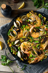 Homemade Spanish Seafood Paella (brent.hofacker) Tags: background chicken clam cooked crayfish cuisine delicious dinner dish fish food gourmet healthy meal mediterranean mollusk mussel mussels oil olive paella paellera pan parsley prawn prawns prepared rice rustic saffron seafood seafoodpaella shellfish shrimp spain spanish spanishpaella spice table traditional typical vegetable vegetarian yellow
