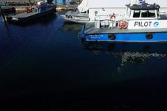 """Tymac Pilot Six"" (Eric Flexyourhead) Tags: vancouver canada britishcolumbia bc burrardinlet portmetrovancouver portofvancouver harbour port dock launch boat boats tymac pilotboat water ocean ripples reflections blue ricohgr"