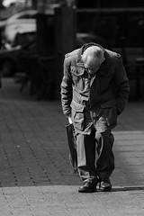 051 (boeddhaken) Tags: thenetherlands holland rotterdam city europe travel southholland streetfotography man walking oldman blackwhite