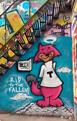 RIP to the Fallen (Georgie_grrl) Tags: ripstephenhawking graffiti graffitialley streetart colourful creative toronto ontario tribute tothefallen cat angel halo heartbomb tagging clouds stairwell
