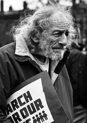 Marching On (trochford) Tags: marcher portrait candid natural man old elderly male face urban street march protest rally marchforourlives boston bostonma bostonmassachusetts ma massachusetts newengland unitedstates us usa bw bnw blackandwhite blackwhite noiretblanc blancoynegro mono monochrome canon canon6d ef24105mmf4lisusm ef24105