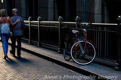 Sydney Town (ANNIE MARTIN PHOTOGRAPHIC IMAGERY) Tags: sydney australia street light afternoon dust old red building black fence cobble road lovers romance evening dinner dining out the rocks martin place summer time walking together happy bicycle