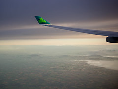 Happy Saint Patrick's Day (tkolos) Tags: stpatrick saintpatricksday irish ireland aerlingus dublin sunrise flying landscape travel avgeek aviation airbus a330 a330300 wingview wing winglet 330 canon windowseat