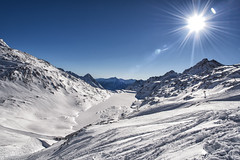 Sunny day in Alps (mystero233) Tags: sun flare alps molltaler gletcher glacier snow austria europe winter cold freezing white mountains mountain lake frozen ski skiing skiers lift blue sky outdoor landscape