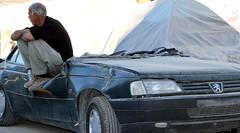 The man who lost his car. (Mahmoud R Maheri) Tags: earthquake kermansshah iran damagedcar man car carowner smashedcar earthquakedamage sarpolzahab despair