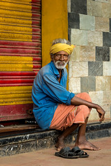Patience (eyecandyclick) Tags: patience sitting sandals beard kerala primefocus tellingastory wise oldman portrait realindia travelphotography canon feet blueshirt yellow colourful india