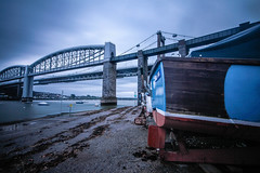 Boats and bridges (NikNak Allen) Tags: plymouth devon saltash cornwall tamar rivertamar bridge tamarbridge roadbridge trainbridge brunelbridge brunel architecture metal brick river water crossing boat blue wide sky clouds longexposure early morning seaweed slipway