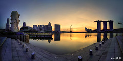 Merlion Park before sunrise (Ken Goh thanks for 2 Million views) Tags: panorama stitch merlion esplanade marina bay cityscape singapore flyer sunrise morning water reflection golden blue sky haida nd filter pentax k1 laowa 12mm f28