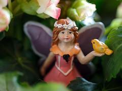 Life among the Flowers. (dshoning) Tags: macromonday fairy flowers leaves bird girl