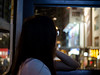 Gazing out of the window (absoluteforecast) Tags: hong kong tram gazing dreamy girl window night travel olympus