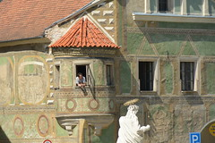 what is going on there? (Hayashina) Tags: moravia telč czechrepublic window architecture statue person hww shadow