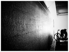Urban Biker - Undergraund walking (明遊快) Tags: japan man light shadow city japanese bike bw blackandwhite walls contrast street road urban