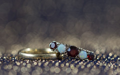 circles of life (Emma Varley) Tags: ring gold garnet opal macromondays circles jewellery bokeh precious family