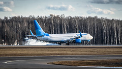 Smoky touchdown (Nick Aviator) Tags: boeing 737 pobeda airlines aero smoke touchdown landing runway airport moscow vnukovo sky clouds forest aviation nikon gear engines