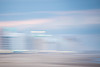 Pastel Moods (haddartist) Tags: beach sand coast coastal shore shoreline ocean oceanside oceanfront boardwalk hotel hotels lights sky clouds cloudy weather sunset dusk evening color colorful pastel blur slowshutter pan panning longexposure artsy artistic motion movement virginiabeach virginia