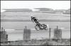 Interesting riding style (G. Postlethwaite esq.) Tags: bw canonae1 tamron300mmf56 blackandwhite film monochrome motorbikes motorcycle photoborder racing stuntrider davetaylor yamahaxs650