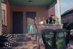 Porch light, trophies (ADMurr) Tags: la porch trophies shadow pink green trash cans memory light leica m6 50mm summicron kodak 200 ccc347