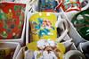 Cups for sale (Eric Flexyourhead) Tags: higashichaya 東茶屋街 kanazawa kanazawashi 金沢市 ishikawa 石川県 hokuriku 北陸地方 chubu 中部地方 japan 日本 city urban detail fragment shop store porcelain japanese cup kitchenware flower floral yellow red ricohgr