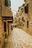 Narrow stone street of Trogir.jpg (marcoverch) Tags: turists trogir city seaside croatia europe travel street architecture diearchitektur strase town stadt dorf reise gothic gotisch old alt building gebäude narrow eng urban städtisch cobblestone kopfsteinpflaster alley gasse house haus ancient pavement pflaster noperson keineperson wall mauer tourism tourismus stone stein outdoors drausen pet tulip metal airport boeing reflections door stairs woods natural