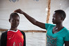 May 17, 2017. Two teenage girls take part in a drama act as part of a counseling programme for adolescent girls in Bidibidi Refugee Settlement, West Nile Region. Conflict and famine in South Sudan have led to an exodus of refugees into Uganda. Picture: JA (Dining for Women) Tags: 12to18yearsold adolescence adult boy childcare childfriendlyspace childreninconflictandemergencies childrennotinschool conflict displacedchildren displacedpeople emergencies emergencysupplies girl infantsunder1year mother refugee reliefaid unaccompaniedchildren southsudan