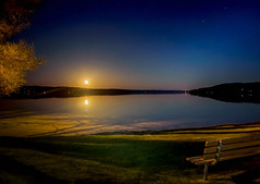 Bench in the Moonlight (T P Mann Photography) Tags: torchlake lake sea water relections moon moonlight bench lonely color night dark longexposure beach shore light canon michigan