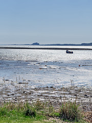 View Across to Bamburgh #1 (Novocastria Photography) Tags: select lindisfarne holyisland sea seaside coast rock rocks sand tide outgoingtide vintagephotograph newcastlechronicle northernecho boat bamburgh bamburghcastle
