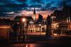 Haarlem nights (reinaroundtheglobe) Tags: haarlem city cityshots cityscape evening longexposure noordholland nederland netherlands marktplein downtown streetlights streetphotography skycolorful clouds lantern illuminated