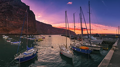 Amanecer En El Puerto (Jörg Bergmann) Tags: islascanarias lagomera panasonic1232mmf3556 tina vallegranrey amanecer beautiful canarias canaryislands cliffs clouds españa fisherboat gf7 gomera harbour lumix m43 mft microfourthirds ocean panasonic port sailing sea seascape sky spain spring stitched sun sunrise sunset travel vacation water harbor boats wallpaper