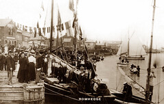 The Quay, Rowhedge (footstepsphotos) Tags: rowhedge essex quay boat sail crowd people regatta flags wooden sea event old vintage postcard past historic