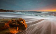 Gold Nugget (ianbrodie1) Tags: golden rock newbigginbythesea northumberland beach sand light colour cloud church water ocean sea seascape coast coastline leefilters longexposure houses waves