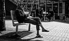 relaxed sunday (Chilanga Cement) Tags: fuji fujix100f x100f xseries fujifilm bw blackandwhite monochrome people candid street streetphotography coventry girl lady relax relaxing pavement sidewalk sitting shadow shadows shoes group headscarf phone