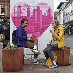 Love MCR (Mick Steff) Tags: sign eating urban street people talking manchester duo two couple