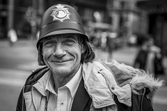 Sound of the Polis (Leanne Boulton) Tags: urban street spontaneous candid portrait portraiture streetphotography candidstreetphotography candidportrait streetportrait closeup streetlife eyecontact candideyecontact man male face eyes smile smiling expression mood emotion feeling police hat costume disguise friendly character tone texture detail depthoffield bokeh dutchangle bokehlicious naturallight outdoor light shade city scene human life living humanity society culture people lifestyle canon canon5d 5dmkiii 70mm ef2470mmf28liiusm black white blackwhite bw mono blackandwhite monochrome glasgow glaswegian scotland uk