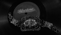 Silvertone (Rand Luv'n Life) Tags: odc our daily challenge antique 78rpm record negro gospel spiritual singing reverend gates congregation sermon black american history silvertone monochrome blackandwhite steel cut victorian rhinestone bracelet indoor composition macro jewelry vintage
