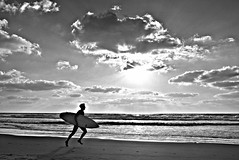 (Roi.C) Tags: sun clouds sky skyline water sea waves man people surfer surfing running beach sand season seascape landscape outdoor sunset silhouette nikkor nikon nikond5300 reflection black white blackwhite blackandwhite bw monochrome telaviv israel