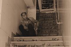 A quiet place for a smoke (Chris Brady 737) Tags: hamadan iran street cigarette smoking sepia staircase stairwell farsi persian