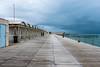 the tale of the fisherman (*magma*) Tags: ostia pioggia rain mare sea cabine cabins frangiflutti molo pier pontile pescatore fisherman ragazzi boys fishing