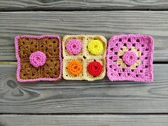 Three rosette granny squares ready for adventure (crochetbug13) Tags: crochetbug crochetsquares grannysquares crochet crocheted crocheting