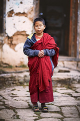 Bhutan: Portrait of a Young Monk. (icarium82) Tags: bhutan travel canoneos5dmarkiv canonef85mmf12lii drukyul haavalley himalayas monk buddhist portrait naturallight monastery mahayanabuddhism traditional rural traditionalclothing traditionaldress robe