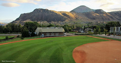 Charles Anderson Baseball Stadium, Exhibition Park, Kamloops from the Rocky Mountaineer - Leaving Kamloops enroute to Revelstroke, British Columbia, Lake Louise & Banff, Alberta, Canada (Black Diamond Images) Tags: kamloops banff kamloopstobanff alberta britishcolumbia rockymountaineer rockymountaineerroute souththompsonriver thompsonrivervalley thompsonrivercanyon thompsonrivergorge canadianrockies vancouvertokamloops canadiantourism armstronggroupltd goldleaf goldleafdomecoach train railroad railway travelphotography landscapes mountain mountainside landscape canada charlesandersonstadium charlesandersonbaseballstadium exhibitionpark