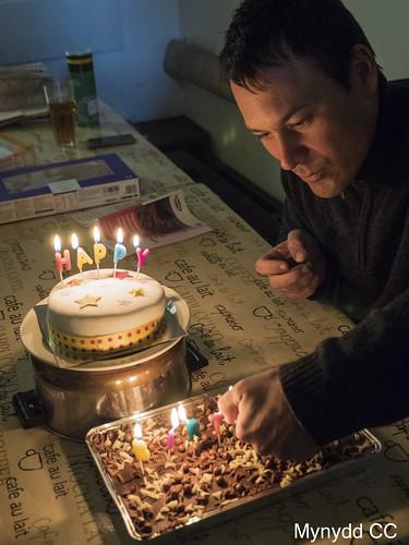 Matt Box - lighting candles for Chris Moore_s Birthday_Photo David K