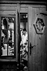 The chef. (Mister G.C.) Tags: street urban photography blackandwhite bw canon canonae1 canonae1program soligor primelens manual manualfocus slr streetphotography urbanphotography shot image photograph candid people frame framed framing doorway door funfair fair fairground cooking monochrome town city vintage analog analogphotography 35mm film schwarzweiss strassenfotografie mistergc germany niedersachsen lowersaxony deutschland europe 50mm f18 50mmf18 prime fd