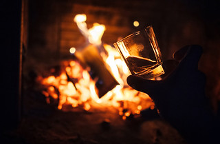 Whiskey glass with bonfire background