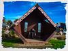 Having Lunch at the Pentagon (Steve Taylor (Photography)) Tags: tinyhuts wharau manaiawilsonmoses maori architecture digital art blue brown green white red newzealand nz southisland canterbury hut christchurch newbrighton whare