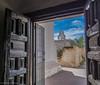 San Xavier Mission (Karen J. Patterson) Tags: sky clouds steeple woodendoor doorway bells catholic priest architecture navajo desert historic church mission tucson arizona unitedstates us