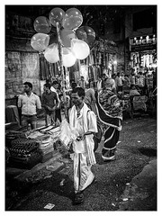 Varanasi, 2018 (Exit Imago) Tags: asia india uttarpradesh varanasi bw balloon blackandwhite man night selling street
