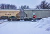 Grain Cars Race Through Town On A  Snowy April Afternoon (Dave Linscheid) Tags: railroad train winter spring railroadcrossing stopsign digitalpainting topazsimplify butterfield watonwancounty mn minnesota usa agriculture