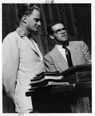 VERY Young Billy Graham and Bibles (Brett Streutker) Tags: lutheran methodist episcopal assemblies apostolic fundamentalist nostalgia antique school religion time old israeli israel palastine joseph mary diciples apostles samaria jerusalem bethlehem brirth passover christmas herod thus version international standard american new james king moody seminary conference epistles gospels john enemy devil satan antichrist son tribulation revelation study verse psalm tent meeting gospel evangelical saved again born jehovah yahweh god rapture scriptures bible he made creationism creation science jesus creator christ easter 2017 stars
